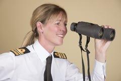 Naval officer holding binoculars Stock Photo