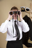 Naval officer holding binoculars Royalty Free Stock Image