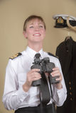 Naval officer holding binoculars Stock Photos