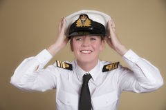Naval officer holding her hat Royalty Free Stock Photography