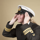 Naval officer holding her hat Royalty Free Stock Photo