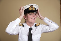 Naval officer holding her hat Stock Photos