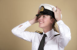 Naval officer holding her hat Royalty Free Stock Images
