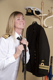 Naval officer tying uniform tie Stock Photography