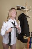 Naval officer tying uniform tie Stock Image