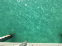 Clear Green Water on the Gulf Coast. The Navarre Beach Pier located along the Florida gulf coast. Clear bright green water. Navarre Beach, Florida Royalty Free Stock Photo