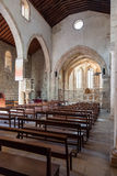 The nave, aisle and altar of the medieval church of Santa Cruz. Royalty Free Stock Photos