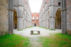 Nave and altar of the Abbey of San Galgano, the famous cathedral without a roof in Tuscany near Siena. Royalty Free Stock Image