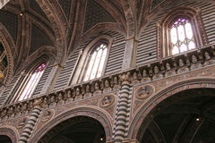 Nave arcade with Renaissance busts of popes and emperors. Internal view of Duomo di Siena. Tuscany. Italy. Stock Photo