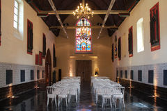 Nave of a chapel - Lille - France. White chairs were installed in the nave of a chapel in Lille (France Stock Photo