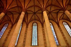 Nave of the church of Les Jacobins with pilars,  arches, and stained glass in Toulouse. Nave of the church of Les Jacobins with pilars,  arches, and stained Royalty Free Stock Photography