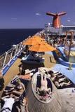 Nave da crociera di carnevale - esponendo al sole sulla piattaforma Fotografie Stock Libere da Diritti