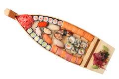 Nave de madera con los rodillos y el sushi Imagen de archivo libre de regalías