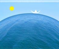 Nave di carta nel mare Fotografia Stock