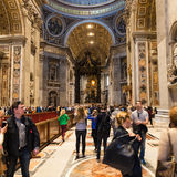 Nave of Papal Basilica of St Peter in Vatican. VATICAN, ITALY - NOVEMBER 2, 2016: tourists in Papal Basilica of St Peter. Basilica is Catholic Cathedral, the royalty free stock image