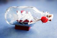 Nave in una bottiglia. Immagini Stock