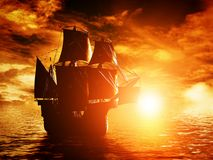 Navegación antigua del barco pirata en el océano en la puesta del sol