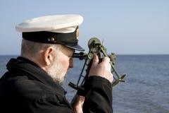 Navegador con el sextante Imagen de archivo libre de regalías