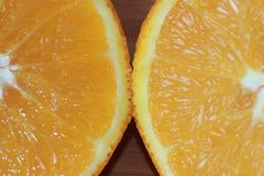 Navel orange cut in half royalty free stock photo