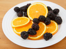 Navel orange and fresh blackberries Royalty Free Stock Image