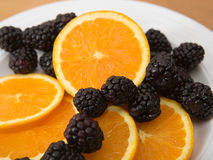 Navel orange and fresh blackberries Stock Photos