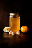 Navel Orange Juice in Jar and White Cluster Petal Flowers Photo Royalty Free Stock Photos