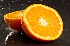 Navel orange with rain drop Stock Photography