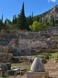 Navel stone in Delphi, Greece Royalty Free Stock Photo
