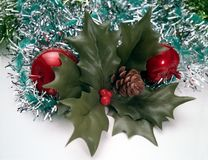 Navidad_a22d9983. Christmas decoration with green leaves, and apples stock images