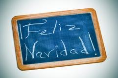 Navidad de Feliz, Feliz Navidad en español Imagen de archivo libre de regalías