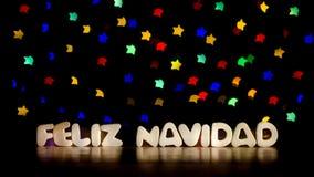 Navidad de Feliz, Joyeux Noël dans la langue espagnole Photographie stock libre de droits