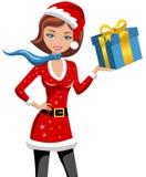 Navidad de la mujer que sostiene el regalo aislado Imagenes de archivo