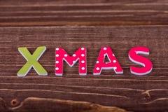 Navidad de la palabra de letras de madera imagenes de archivo