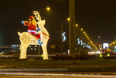 Navidad de Santa Claus e instalación de la luz del Año Nuevo Imagen de archivo libre de regalías