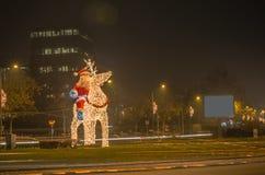 Navidad de Santa Claus e instalación de la luz del Año Nuevo Foto de archivo libre de regalías