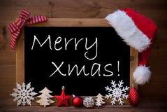 Navidad de Santa Hat Christmas Decoration Merry de la pizarra de Brown Fotografía de archivo