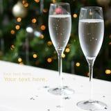 Navidad del Año Nuevo de los vidrios de Champán Fotos de archivo