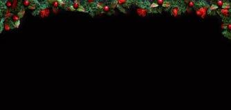 Navidad ennegrece el fondo enmarcado con las decoraciones de la estación, espacio para un texto Fotos de archivo libres de regalías