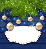 Navidad greeting card with golden balls and fir branches Stock Image