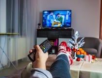 Navidad Mujer que ve la TV Fotografía de archivo