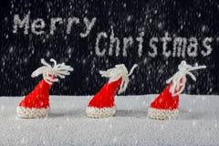 Navidad-sombreros y nieve Fotografía de archivo