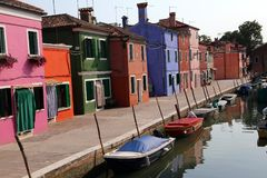 Navigable canal and the colorful houses of the BURANO island nea. The navigable canal and the colorful houses of the BURANO island near Venice in Northern Italy Stock Photography