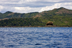 Navigable lagoon. Cloudy hill navigable lagoon and coastline in madagascar nosy be Stock Images