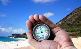 Navigate in Hawaii Islands. Navigating in Hawaii with a compass in hand Stock Photography