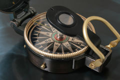 Navigating compass. Old navigating compass against a dark background Royalty Free Stock Photo