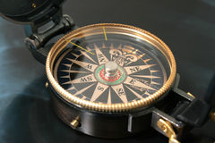 Navigating compass. Old navigating compass against a dark background Royalty Free Stock Photography