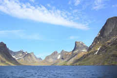 Navigating in the fjord of Reine in Lofoten Stock Images