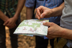 Navigating with map and compass Royalty Free Stock Photography