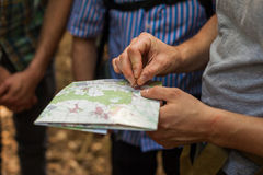 Navigating with map and compass Royalty Free Stock Images