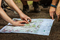 Navigating with map and compass Stock Photos